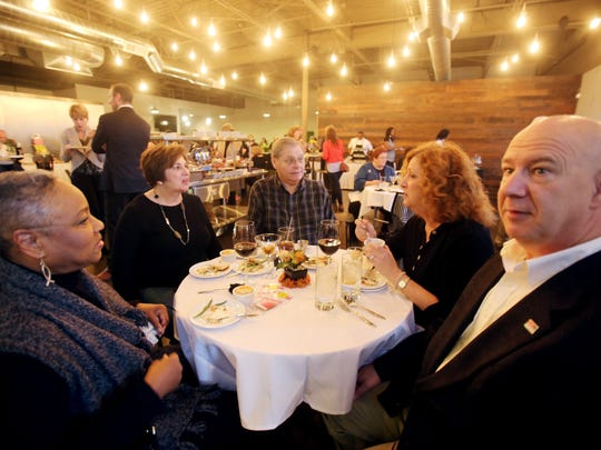 Mabel Flowers of Southfield, left, Sandy Laroo of Livonia, Guy Laroo of Livonia, Maureen Mansfield of Farmington Hills and Mike Mansfield of Farmington Hills all enjoy the tastings and company during the Detroit Free Press Feast Thanksgiving tasting event at the Great Lakes Culinary Center in Southfield.