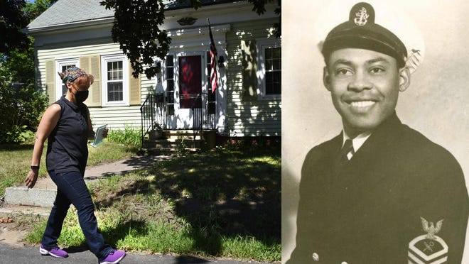 The Rev. Lillian Buckley walks by her family's home on Manson Street Ext. in Kittery. The town is renaming the street to Buckley Way in honor of her father, retired Naval Chief Petty Officer Bishop L. Buckley Sr., pictured at right.