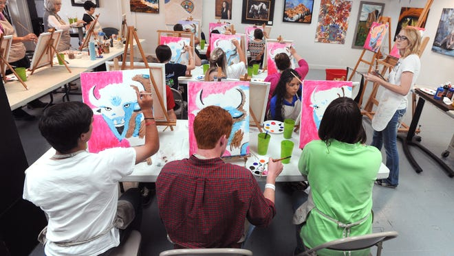 Julie Simer teaches an art class to gifted high school students from Stanton at Studio 13 Monday.
