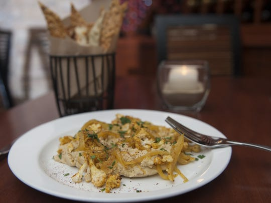 A Mediterranean hummus served at Seasons 52 in Cherry Hill is made with roasted cauliflower and onions, and seasoned with sumac, a staple in Greek cuisine.