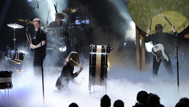 Imagine Dragons perform at the 2013 American Music Awards in Los Angeles.