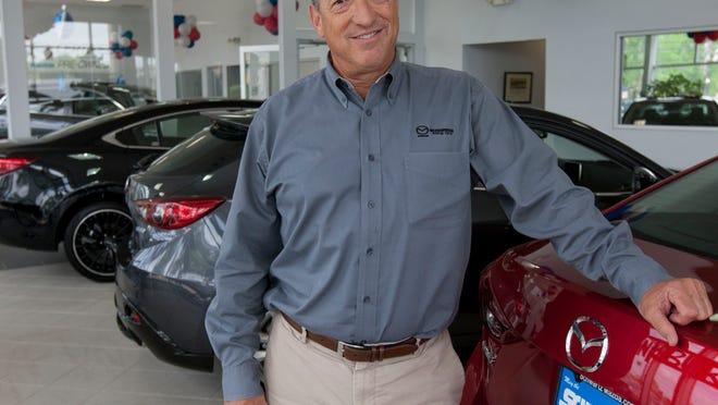 Jon Schwartz, owner of Schwartz Mazda, poses in his Shrewsbury dealership.