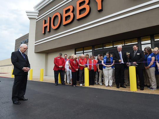 Winston Hackett, of Hobby Lobby corporate offices in Oklahoma City, leads a prayer Monday morning before a ribbon-cutting ceremony at the new Mountain Home store.
