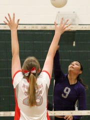 Mescalero's Lauryn Yuzos, right, hits a ball over Mountainair's