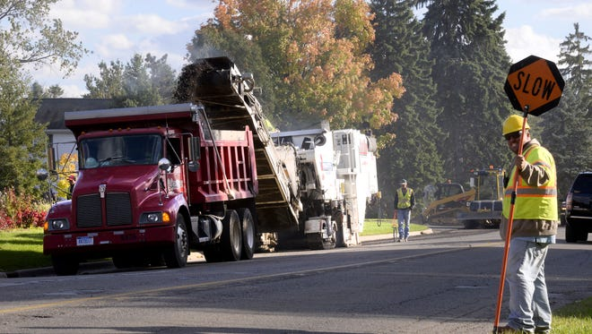 Crews work on a small section of roadway on Canal Rd. in Delta Township in Eaton County  Wednesday October 8, 2014.