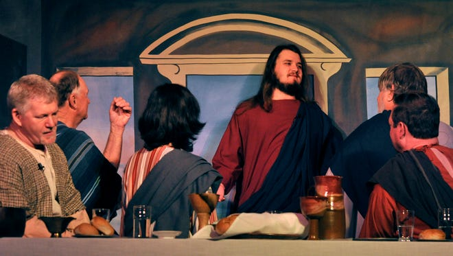 Jared Kingston (center) portrays Jesus in a dress rehearsal for the Living Last Supper at St. James United Methodist Church Wednesday March 21, 2018. Kingston, 21, grew his hair out for three years to play the part. The play is a tableau depicting Leonardo DaVinci's Last Supper with actors representing the figures and stepping forward to deliver a monologue.