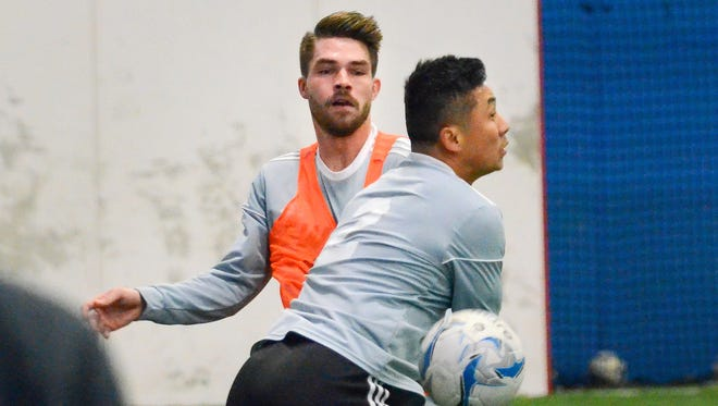 Andrew Wiedabach (rear, pictured with Tenzin Rampa at an early-season practice), has worked out with the Wave for four years but has played in only two games this season heading into the finale.