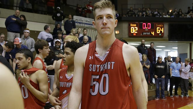 A dejected SouthportÕs Joey Brunk (50) walks off the court following their loss in their IHSAA Class 4A Semi-State Boy's Basketball game Saturday, Mar 19, 2016, afternoon at Richmond High School in Richmond IN. The Southport Cardinals lost to the New Albany Bulldogs 82-64.