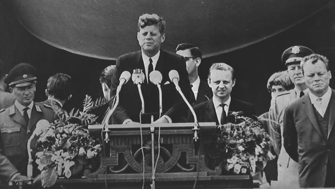 "President John F. Kennedy delivers his famous speech ""I am a Berliner"" (""ich bin ein Berliner"") in front of the City Hall in West Berlin on June 26, 1963."