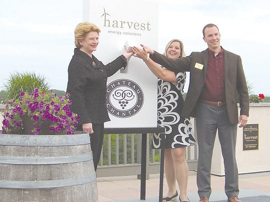 U.S. Senator Debbie Stabenow (left) joins Chateau Chantal President and CEO Marie-Chantal Dalese and Harvest Energy Solutions President Chris Curry to flip the switch, signifying the use of a new solar array recently installed at the Grand Traverse Bay winery.