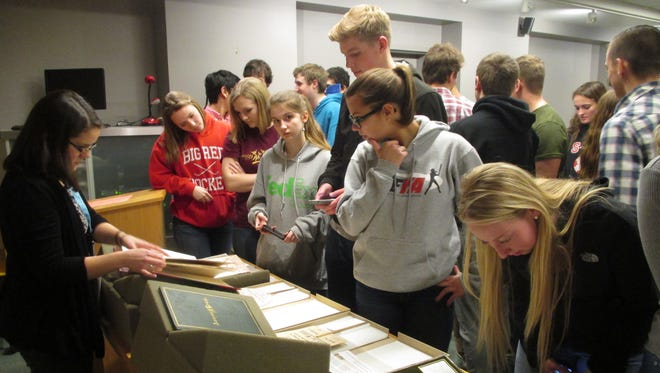 On  March 31, Spencer-Van Etten High School held a career exploration day with S-VE graduates returning to discuss their careers with today's students. Field trips to various workplaces and colleges were part of the day's agenda. One group went to Cornell University and during their tour visited the Kroch Library, where S-VE graduate and archivist Tabitha Cary works. She shared a dozen artifacts with the students, including cuneiform tablets, a lock of Charles Dickens' hair, fans with pro/con slogans on women's suffrage, and manacles worn by American slaves.