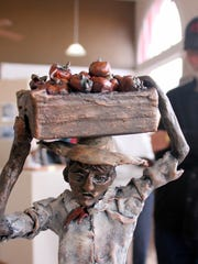 Local artist Diana LeMarbe  displayed many of her sculptures depicting Bracero laborers working various jobs as part of the art exhibit at the Deming Arts Center.