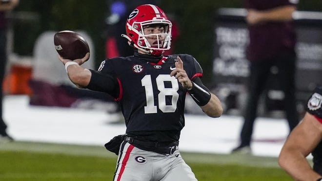 Nov 21, 2020; Athens, Georgia, USA; Georgia Bulldogs quarterback JT Daniels (18) throws a touchdown pass against the Mississippi State Bulldogs during the first half at Sanford Stadium. Dale Zanine-USA TODAY Sports