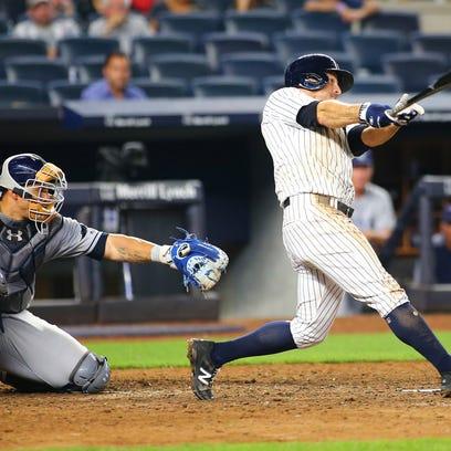 New York Yankees left fielder Brett Gardner (11) hits