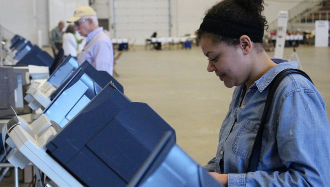 Lexus Scott, 21, cast her vote at the Veterans Memorial Coliseum on Tuesday. Scott said she was encouraged to participate in the primary by her older brother.