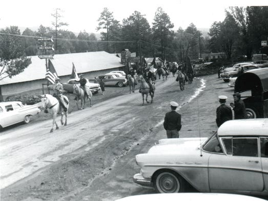"""This historical photo is titled """"Parade October 1957."""""""