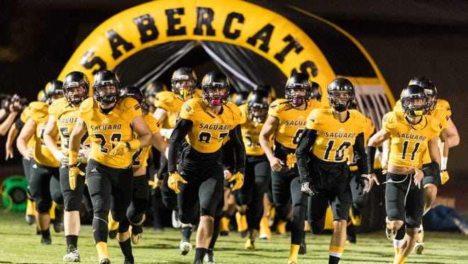 Saguaro takes the field before the Division 4A quarterfinal playoff game against Peoria on Thursday, Nov. 10, 2016, at Saguaro High School in Scottsdale.