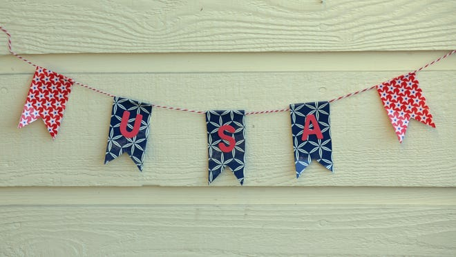 Decorate your patio or picnic area with this simple-to-make ticker tape garland made from duct tape and alphabet stickers.