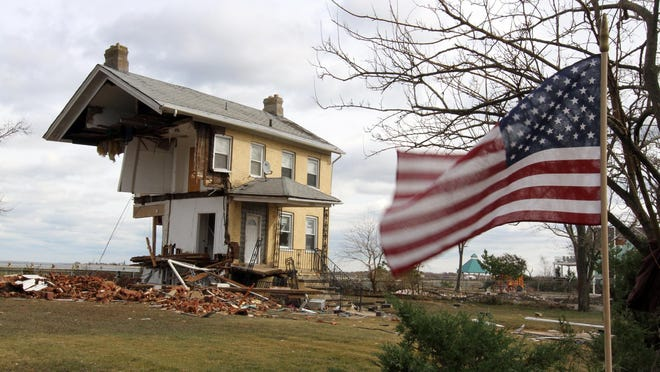 Sandy's destruction of taxable properties, like this home in Union Beach, means higher taxes for many Shore towns. Superstorm Sandy sheared off half of the house, making it a symbol of the storm's destruction.