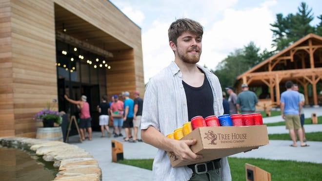 A customer picks up some Tree House favorites. Tree House Brewing Company in Charlton is now the state's largest brewery outside of Boston.