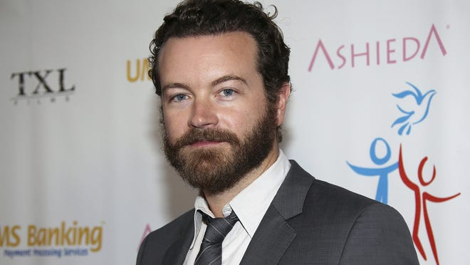 """In this 2014 file photo, Danny Masterson arrives at Youth for Human Rights International Celebrity Benefit in Los Angeles. Masterson, known for his roles in """"That '70s Show"""" and """"The Ranch,"""" has been charged with raping three women."""