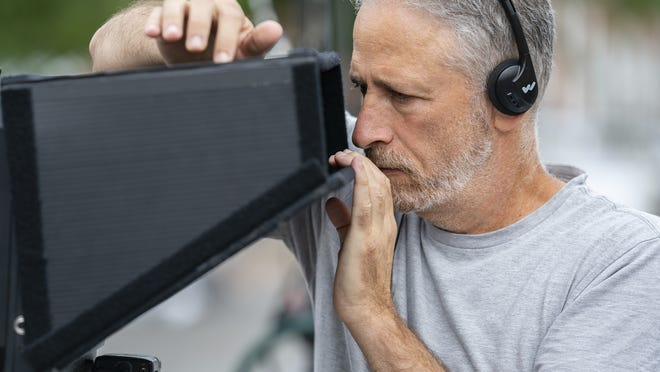 "Director Jon Stewart appears on the set during the filming of ""Irresistible."""