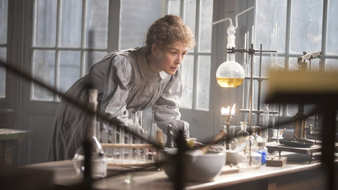 "Rosamund Pike as Marie Curie in a scene from ""Radioactive."""
