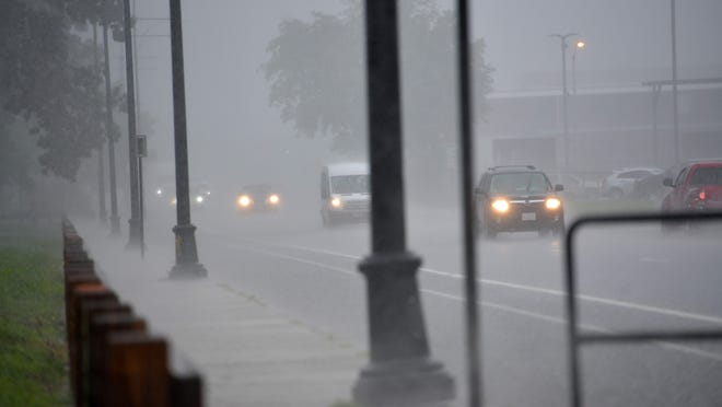 Motorists on Quinsigamond Avenue in Worcester faced blinding rain Thursday.