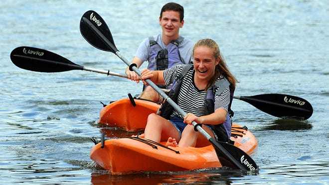 Julia Collamore of Worcester and Matthew Fiore of Grafton paddle on Coes Pond in Worcester in July 2018.