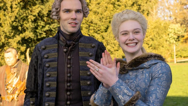 "Nick (Christophe Tek), Peter (Nicholas Hoult) and Catherine (Elle Fanning), in ""The Great."""