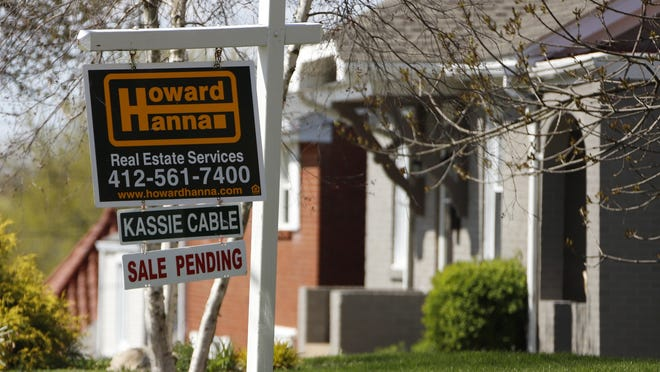 This April 27 file photo shows a sale pending sign on a home in Mount Lebanon, Pa.