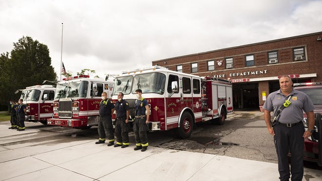 WORCESTER - Members of the Fire Department pause for a moment of silence Friday to honor the lives lost on Sept. 11.