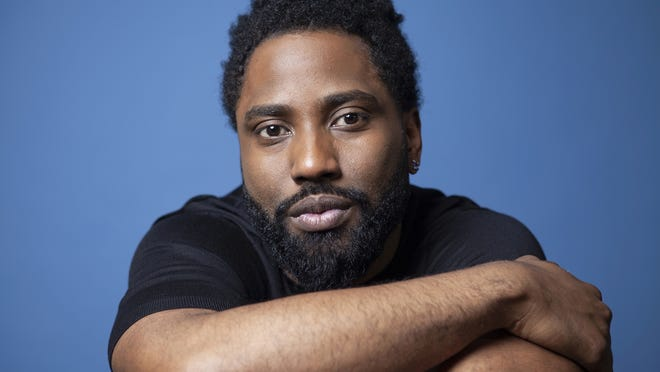 """John David Washington poses for a portrait at the Four Seasons Hotel in Los Angeles in 2018. Washington stars in the Christopher Nolan film """"Tenet."""""""
