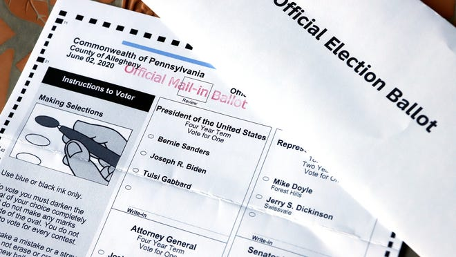 This May 26 file photo shows an Official Democratic General Primary mail-in ballot and secrecy envelope for the Pennsylvania primary.