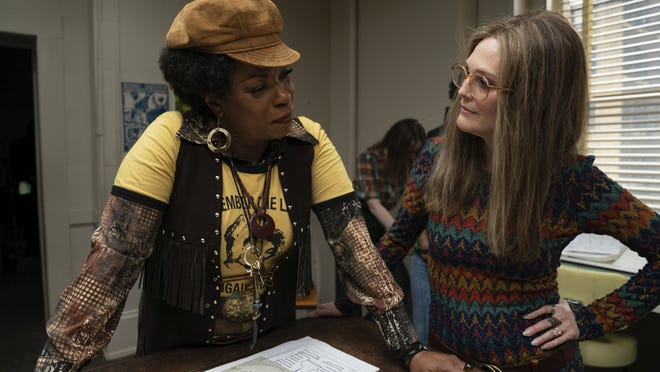 "Lorraine Toussaint as Flo Kennedy, left, and Julianne Moore as Gloria Steinem in a scene from ""The Glorias."""