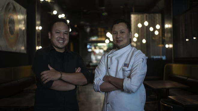 Tam Le and Son Vo pose for a portrait inside their new restaurant, Chashu Ramen +Izakaya, which is on 38 Franklin St. in Worcester.