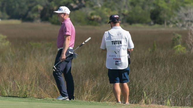Former Armstrong State University standout Shad Tuten, from Naples Florida, and his caddie survey the 18th green during Thursday's opening round of the Savannah Golf Championship at The Landing Club's Deer Creek Course. Tuten shot a 5-under 67 on Thursday and 66 on Friday to made the cut at 11-under.