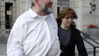David and Judy Wax walk out of federal court in Trenton in 2011.