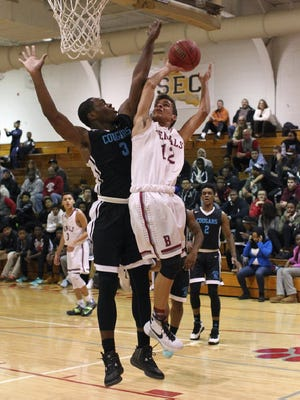 Francis Lorenzo (12) scored 11 points for Bloomfield in an overtime loss to Barringer.