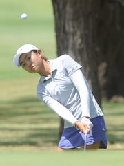 Kyung Eun Lee of Honolulu, Hawaii eyes her shot onto the green at 16 during the final round of the AJGA Folds of Honor Junior Championship hosted by Bob Estes on Thursday, July 19, 2018 at the Abilene Country Club's Club Course. Lee, who shot a final-round 72, won the girls title with a 3-under-par 207, four four strokes better than second-place Olivia Mitchell of Plano.