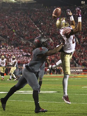 Louisville'sTerell Floyd breaks up a pass intended for Florida State's Rashad Greene. The Cards allowed 401 passing yards and 173 rushing yards. The Seminoles went on to beat Louisville, 42-31. Oct. 30, 2014 By Matt Stone/The C-J