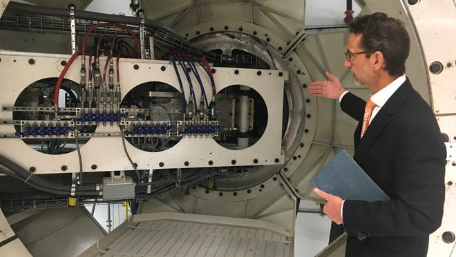 Joe Matteo, president of ProNova Solutions, explains the functions of a 360-degree gantry at the new Provision CARES Proton Therapy Center in Franklin on Thursday, March 1, 2018.