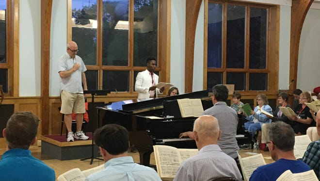 "Masterwork Chorus annually hosts ""Summer Sings,"" a five-week series of informal gatherings of singers from several different choirs.  In this program from 2017, Masterwork music director Chris Shepard (standing, left) leads the vocalists with guest soloists Malcolm Merriweather and Casandra LaMotte in Brahms' Requiem.  The 2018 series begins Wednesday, June 20, and continues for four more Wednesdays at Chatham United Methodist Church."