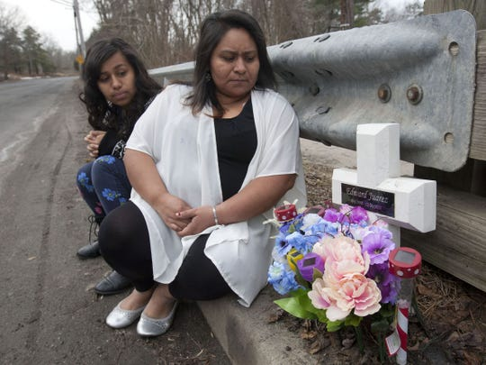 Alberta Juarez (right), Lakewood, with her daughter Beverly, 14 on Clover Street in Lakewood where her 12-year-old son, Eddie, was fatally struck by a hit-and-run driver in 2011.