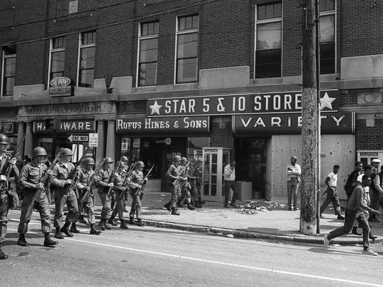 National Guard troops patrolled the streets of Louisville's Parkland neighborhood on May 27, 1968, after nights of rioting over civil rights.