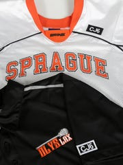 """The Sprague High School lacrosse team will wear black """"CJ6"""" patches on their uniforms the rest of the season in memory of former teammate Connor James, who died April 1."""