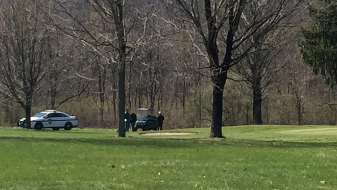 Pennsylvania State Police gather information at the 14th Hole on Monroe Valley Golf Course in Swatara Township where a man died of a self-inflicted gunshot Wednesday morning.