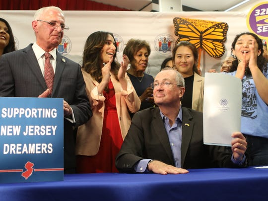 Gov. Phil Murphy signed a bill at Rutgers University in Newark on Wednesday that makes undocumented students eligible for financial aid to attend four-year colleges and universities in the state.
