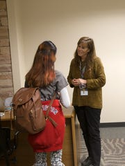 At center, Teaacher Shelly McDaniel talks with students