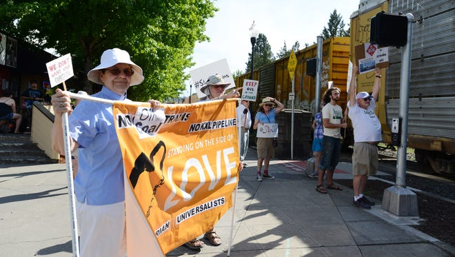 Diana Vezmar-Bailey and other opponents of oil trains protest near the train tracks at 12th and State streets in Salem on Tuesday, July 8, 2014.